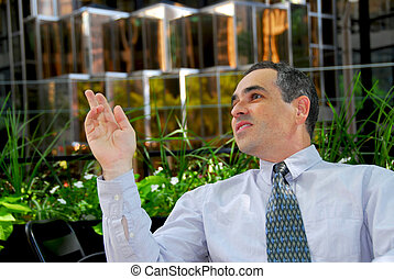 Businessman cafe - Businessman calling a waiter in outdoor...