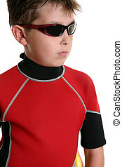 Boy in wetsuit and sunglasses - Surfer boy wearing a wetsuit...