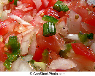 Pico De Gallo Closeu - A Mexican side dish, consisting of...