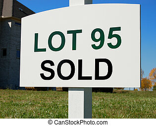 Sold sign on lot of new development