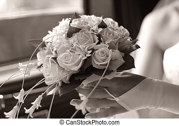 Wedding bouquet - The bride holds a wedding bouquet....