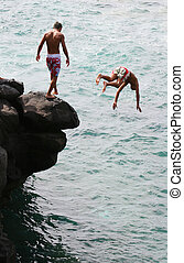 Boys Jumping - Boys jumping into the sea from rocks