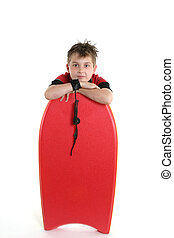 Child resting with a bodyboard - A child casually rests with...