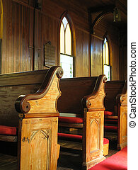 Old Church Pews - late afternoon sunlight falls across old...