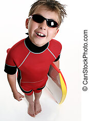 Child ready for the surf - A child dressed in wetsuit and...