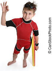 Good Surf - Boy with a surf gear shows the popular a-ok sign...