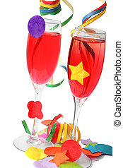 Party Drinks - Red cocktail drinks in champagne flutes with...