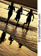 Children Running - Children running on the shore at sunset