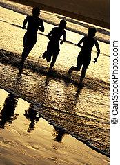 Children Running - Children running on the shore at sunset