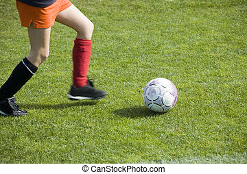 Girls Soccer Player - Girls soccer player dribbling the ball...