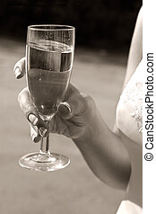 Glass of champagne - Glass with champagne in hands of the...