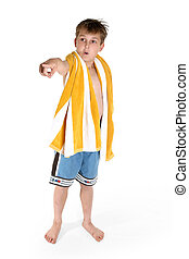 Beach boy pointing - A young curious boy dressed in board...