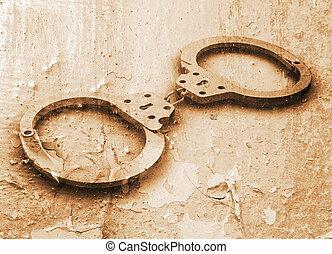 Handcuffs on grunge background