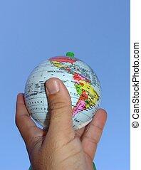Terrestrial globe - Hand holding a terrestrial globe