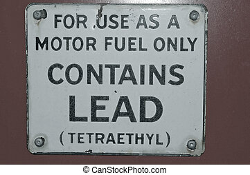 Contains Lead - Close up of gas pump sign - Contains Lead