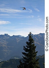 Paraglider over the Swiss Alps