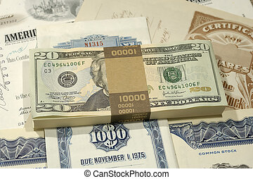 Wealth - Photo of Money on Top of Stock Certificates -...
