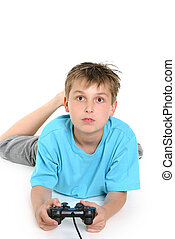 Child playing computer games. - A boy on the floor playing a...