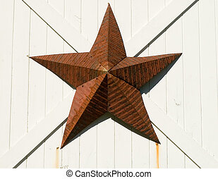 Red Star - Amish decorative red tin star, on a barn door