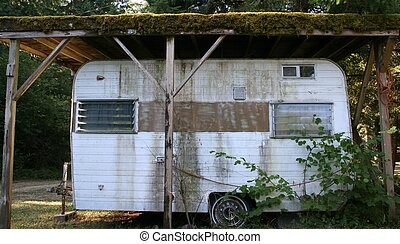 Trashy Trailer - Small and grungy looking trailer in a rural...