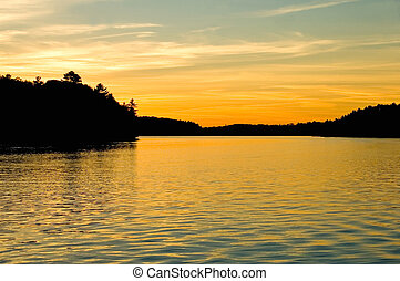 Sunset Lake - Sunset over a lake in cottage country,...