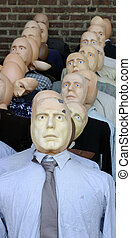 In line. - Group of dolls or dummies representing a crowd of...
