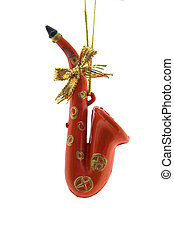 Christmas Decoration - a red saxophone is isolated on a pure...