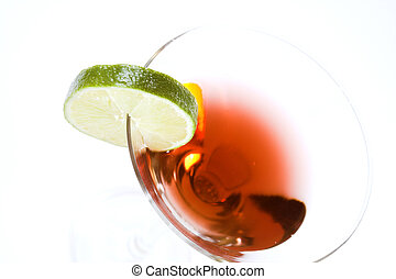 cocktail with green lemon over white background
