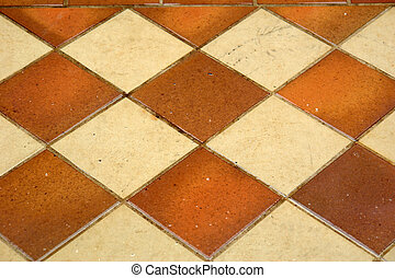 Wet Tiles - diamond pattern of outdoor tiles in the rain,