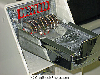 Laundry Day - Quarters in the slots of a washing machine at...