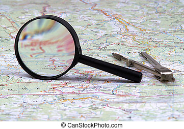Map and glass - Magnifies glass and compasses on map
