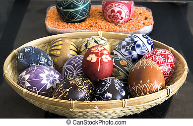 Eastereggs - Easter eggs in basket on dark background