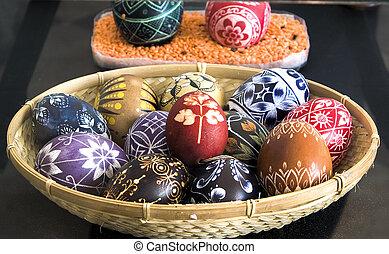 Eastereggs - Easter eggs in basket on dark background