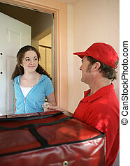 Tip For the Driver - A girl paying the pizza delivery man.