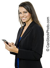 Sending Message - A young businesswoman sending a text...