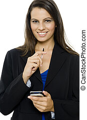 Organized - An attractive young businesswoman with a gadget...