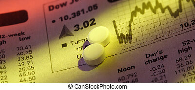 Pills on Stock Price Chart - Close-up shot of pills on stock...