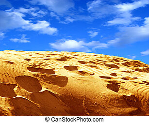 Sand and sky - Vibrant image of cloudy sky and a sand with...