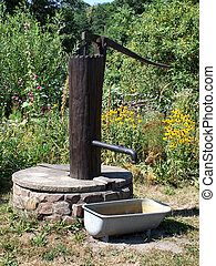 WATER PUMP - OLD WATER PUMP; MADE OF A TREE; WELL; TUB