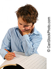 school time - child doing his math homework.