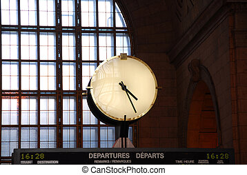 Clock train station - Big clock inside a train station on...