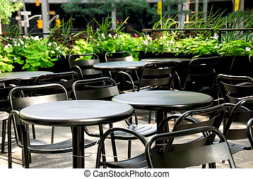 Restaurant patio - Restaurant outdoor patio with black patio...