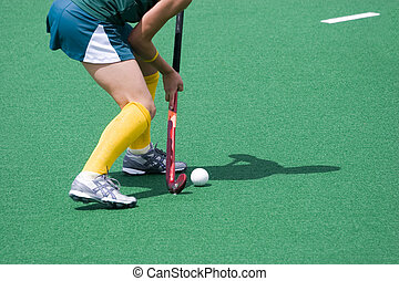 Field Hockey - Hockey player, stick and ball