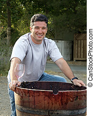Wine maker by the wooden barrel