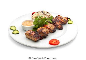 shish kebab with rice and mushrooms