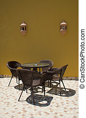 Table with rattan chairs - Coffe table with four rattan...