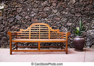 bench on wall - Bench with a stone wall on back