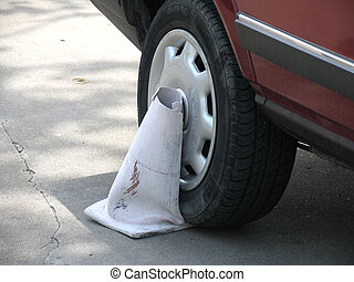 Braking the law - A car stepping on a cone
