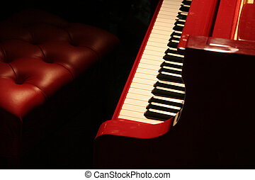 red piano with red bench