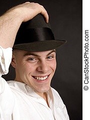 Big smile - Handsome young man tipping his felt hat